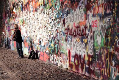 Lone busker lennon wall